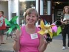 Donna Lohr standing with pinwheels